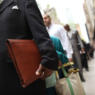 NEW YORK, NY - APRIL 18: Job seekers line-up to attend a job fair at a Holiday Inn on April 18, 2012 in New York City. Although the unemployment rate slipped to 8.2 percent in March, job growth slowed with nonfarm payroll employment rising by only 120,000 raising fears that the labor market could stall again. Most political analysts believe that this years the presidential race will be primarily based on the economic outlook for America. (Photo by Spencer Platt/Getty Images)