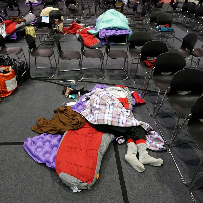 Someone sleeps on the ground in a warming shelter in Austin, Texas.