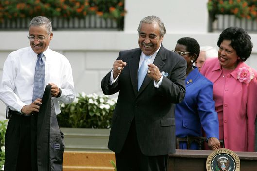 WASHINGTON - JULY 27:  Rep. Charles Rangel (D-NY) (2nd L) gestures alongside Rep Bobby Scott (D-VA) (L) after President Bush signed the Fannie Lou Hamer, Rosa Parks, and Coretta Scott King Voting Rights Act Reauthorization and Amendments Act of 2006 into law on the South Lawn of the White House July 27, 2006 in Washington, DC. Despite a move by conservative House Republicans to force a delay in the routine reauthorization, the bill passed the House 390-33 and the Senate 98-0.  (Photo by Mark Wilson/Getty Images)