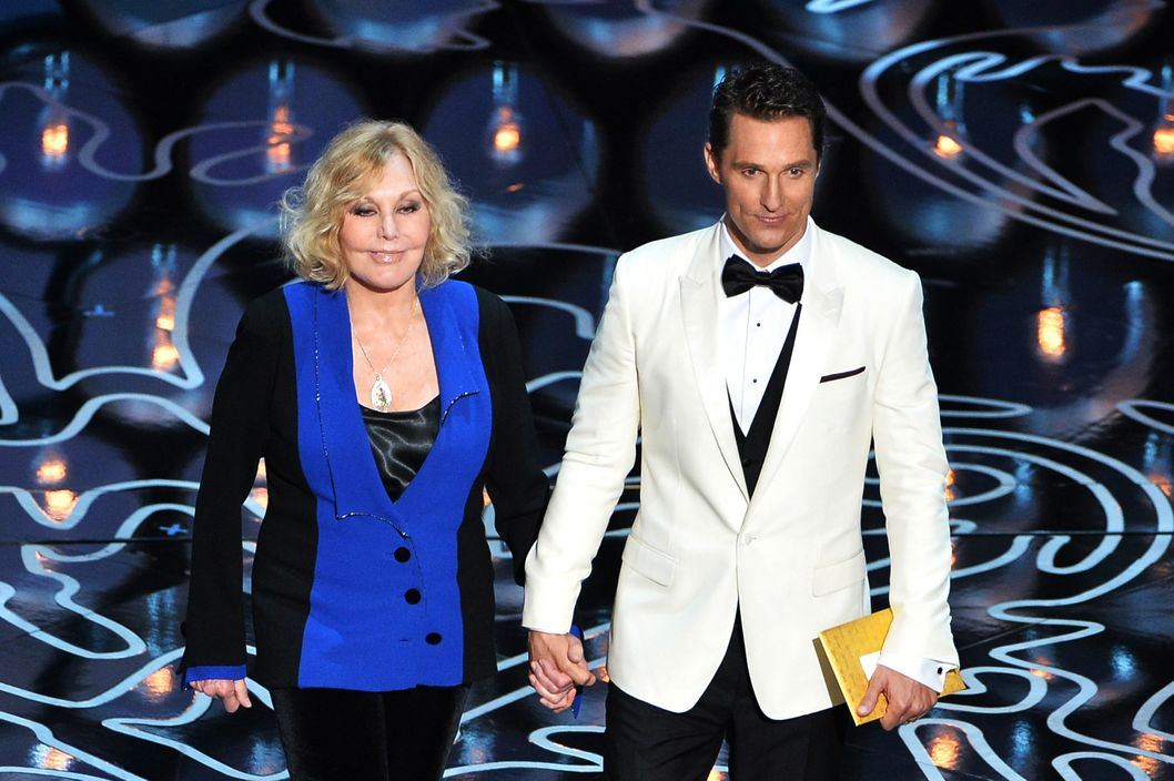 Actors Kim Novak (L) and Matthew McConaughey speak onstage during the Oscars at the Dolby Theatre on March 2, 2014 in Hollywood, California.