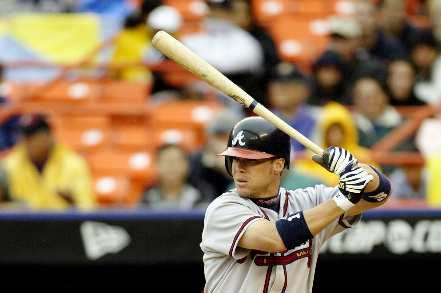 Left fielder Chipper Jones #10 of the Atlanta Braves readies for the pitch during the game against the New York Mets at Shea Stadium  on September 1, 2003 in Queens, New York. The Mets defeated the Braves 3-2.