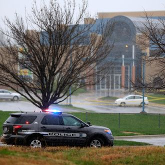 OVERLAND PARK, KS - APRIL 13: A police vehicle sits in front of the Jewish Community Center after three were killed when a gunman opened fire on April 13, 2014 in Overland Park, Kansas. Police arrested and are questioning a suspect. (Photo by Jamie Squire/Getty Images)
