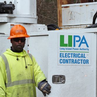 MELVILLE, NY - NOVEMBER 19: An electrical crew member contracted by LIPA works on overhead lines on Old Country Road on November 19, 2012 in Melville, New York. Three weeks after Superstorm Sandy hit the New York area, LIPA continues its restoration efforts in many affected areas on Long Island. (Photo by Bruce Bennett/Getty Images)
