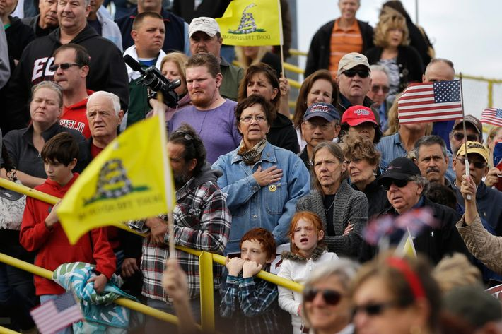 12 Oct 2013, New Jersey, USA --- Supporters stand an bleachers of a racetrack during a rally for Steve Lonegan, left, who is running for the vacant New Jersey seat in the U.S. Senate, Saturday, Oct. 12, 2013, in New Egypt, N.J. Former Alaska Gov. Sarah Palin was also in attendance. She has said Lonegan's Democratic opponent, Newark Mayor Cory Booker, is out of touch because of his