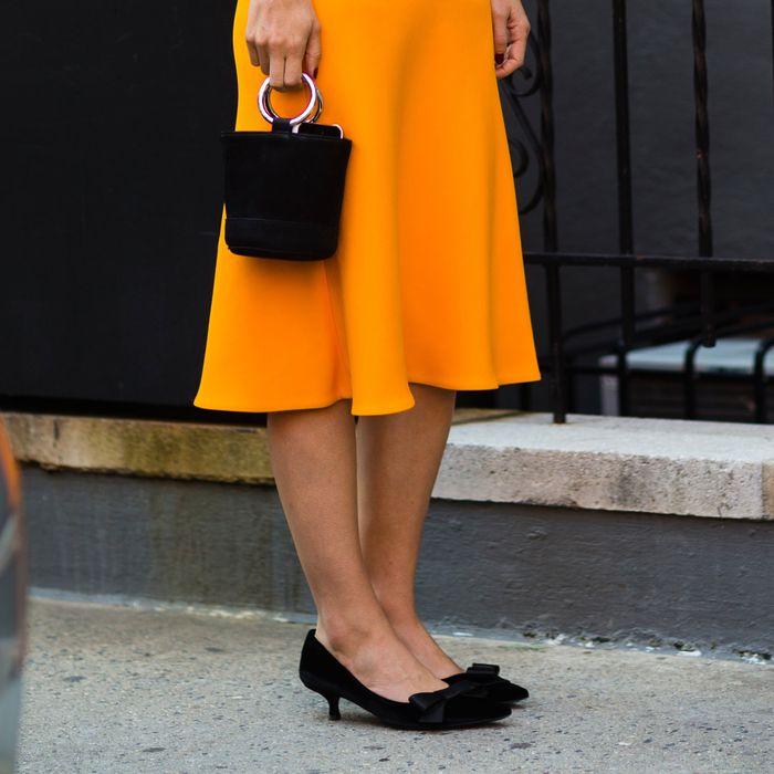 ec0be63ee85 Annina Mislin wears Prada kitten heels during New York Fashion Week. Photo   Nabile Quenum. Photo Editor  Biel Parklee.