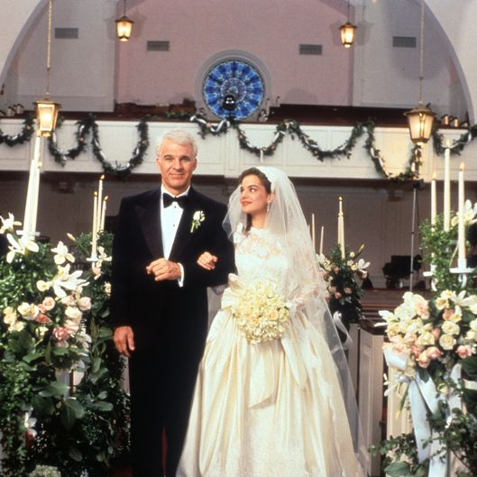 Steve Martin walking down the aisle with Kimberly Williams-Paisley in a scene from the film 'Father Of The Bride', 1991.
