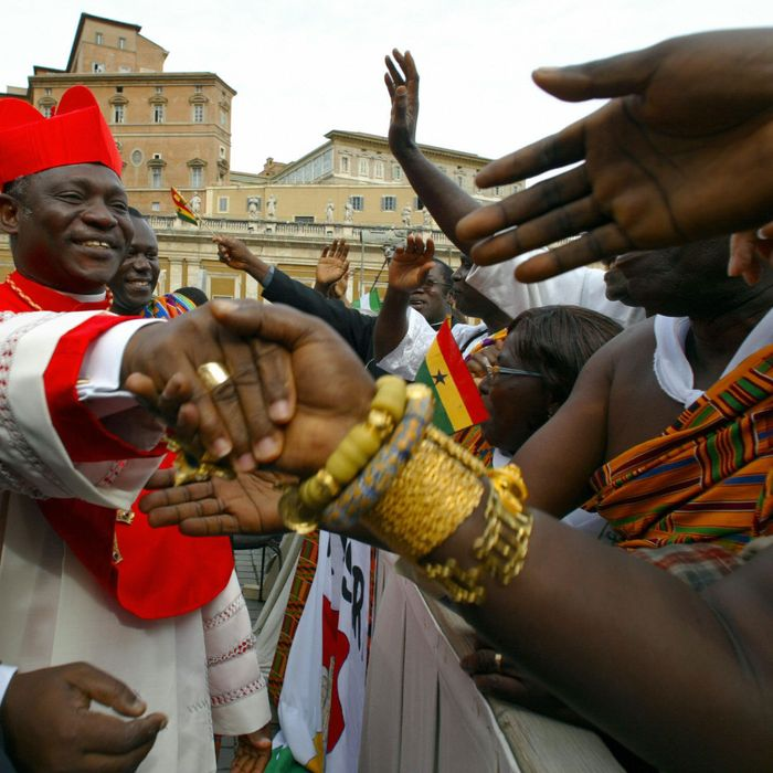 Newly appointed cardinal Peter Kodwo Appiah Turkson of Ghana salutes his compatriots after the ordination ceremony celebrated by Pope John Paul II on St Peter square 21 October 2003 at the Vatican. The 30 cardinals appointed today will bring the Consistory to 135 cardinal-electors who will meet in conclave to elect a next Pope after his death.