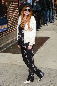 "Actress Lindsay Lohan enters the ""Late Show With David Letterman"" taping at the Ed Sullivan Theater on April 7, 2014 in New York City."