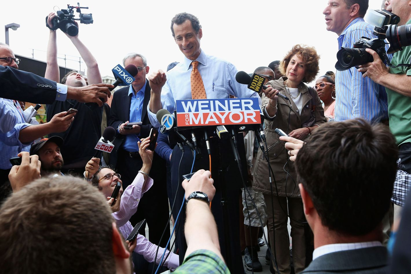 NEW YORK, NY - MAY 23:  Anthony Weiner (C) speaks to the media after courting voters outside a Harlem subway station a day after announcing he will enter the New York mayoral race on May 23, 2013 in New York City. Weiner is joining the Democratic race to succeed three-term Mayor Michael Bloomberg after he was forced to resign from Congress in 2011 following the revelation of sexually explicit online behavior.  (Photo by Mario Tama/Getty Images)