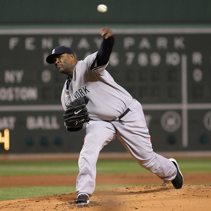 BOSTON, MA - APRIL 10: CC Sabathia #52 of the New York Yankees throws against the Boston Red Sox at Fenway Park April 10, 2011 in Boston, Massachusetts. (Photo by Jim Rogash/Getty Images)