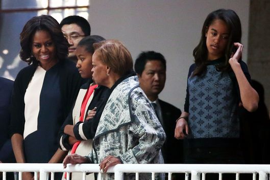 XI'AN, CHINA - MARCH 24:  First Lady Michelle Obama with her daughters Malia Obama and Sasha Obama, mother Marian Robinson visit Museum of Terracotta Warriors during a visit to the historic excavation site on March 24, 2014 in Xi'an, China.  Michelle Obama's one-week-long visit in China will be focused on educational and cultural exchanges.  (Photo by Feng Li/Getty Images)