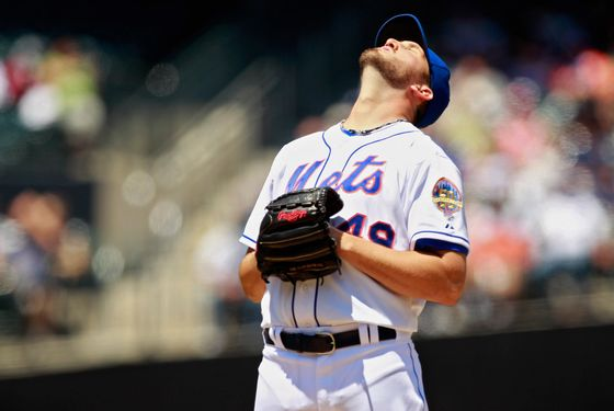 NEW YORK, NY - JULY 22: Jonathon Niese #49 of the New York Mets stretches before the first pitch of the game against the Los Angeles Dodgers at CitiField on July 22, 2012 in the Flushing neighborhood of the Queens borough of New York City.  (Photo by Mike Stobe/Getty Images)