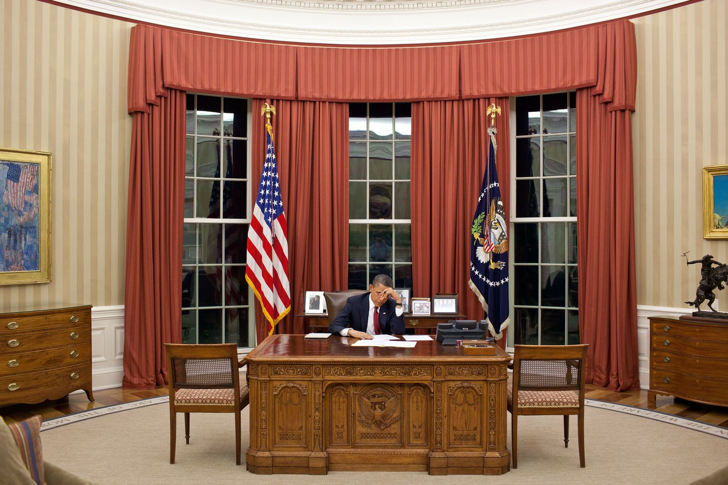 President Barack Obama edits his remarks in the Oval Office prior to making a televised statement detailing the mission against Osama bin Laden