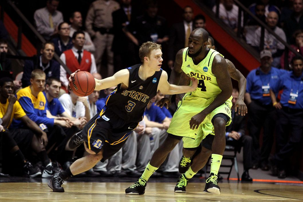 Nate Wolters #3 of the South Dakota State Jackrabbits handles the ball against Quincy Acy #4 of the Baylor Bears during the second round of the 2012 NCAA Men's Basketball Tournament at The Pit on March 15, 2012 in Albuquerque, New Mexico.