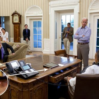 President Barack Obama talks on the phone with House Minority Leader Nancy Pelosi in the Oval Office to discuss ongoing efforts in the debt limit and deficit reduction talks, Sunday, July 31, 2011. Pictured, from left, are: Phil Schiliro; Assistant to the President and Special Advisor; Senior Advisor David Plouffe; Nancy-Ann DeParle, Deputy Chief of Staff for Policy; Bruce Reed, Chief of Staff to the Vice President; Rob Nabors, Assistant to the President for Legislative Affairs; and Vice President Joe Biden.