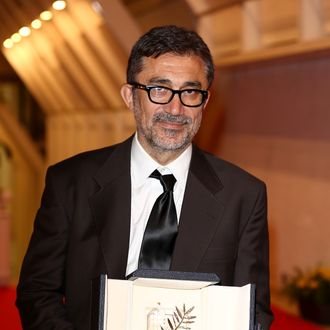 CANNES, FRANCE - MAY 24: Director Nuri Bilge Ceylan poses with the Palme d'Or for his film 'Winter's Sleeps' during the Palme D'Or Winners dinner during the 67th Annual Cannes Film Festival on May 24, 2014 in Cannes, France. (Photo by Tim P. Whitby/Getty Images)