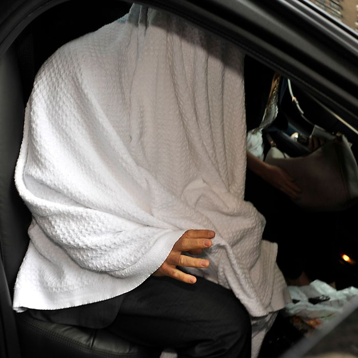 Alec Baldwin covers himself with a white bedding sheet as he leaves The Regency Hotel in NYC with an assistant. Also at the hotel was Woody Allen as they both separately left a 'To Rome With Love' press junket. <P> Pictured: Alec Baldwin <P> <B>Ref: SPL408073 190612 </B><BR/> Picture by: Matthew McDermott / Splash News<BR/> </P><P> <B>Splash News and Pictures</B><BR/> Los Angeles:310-821-2666<BR/> New York:212-619-2666<BR/> London:870-934-2666<BR/> photodesk@splashnews.com<BR/> </P>
