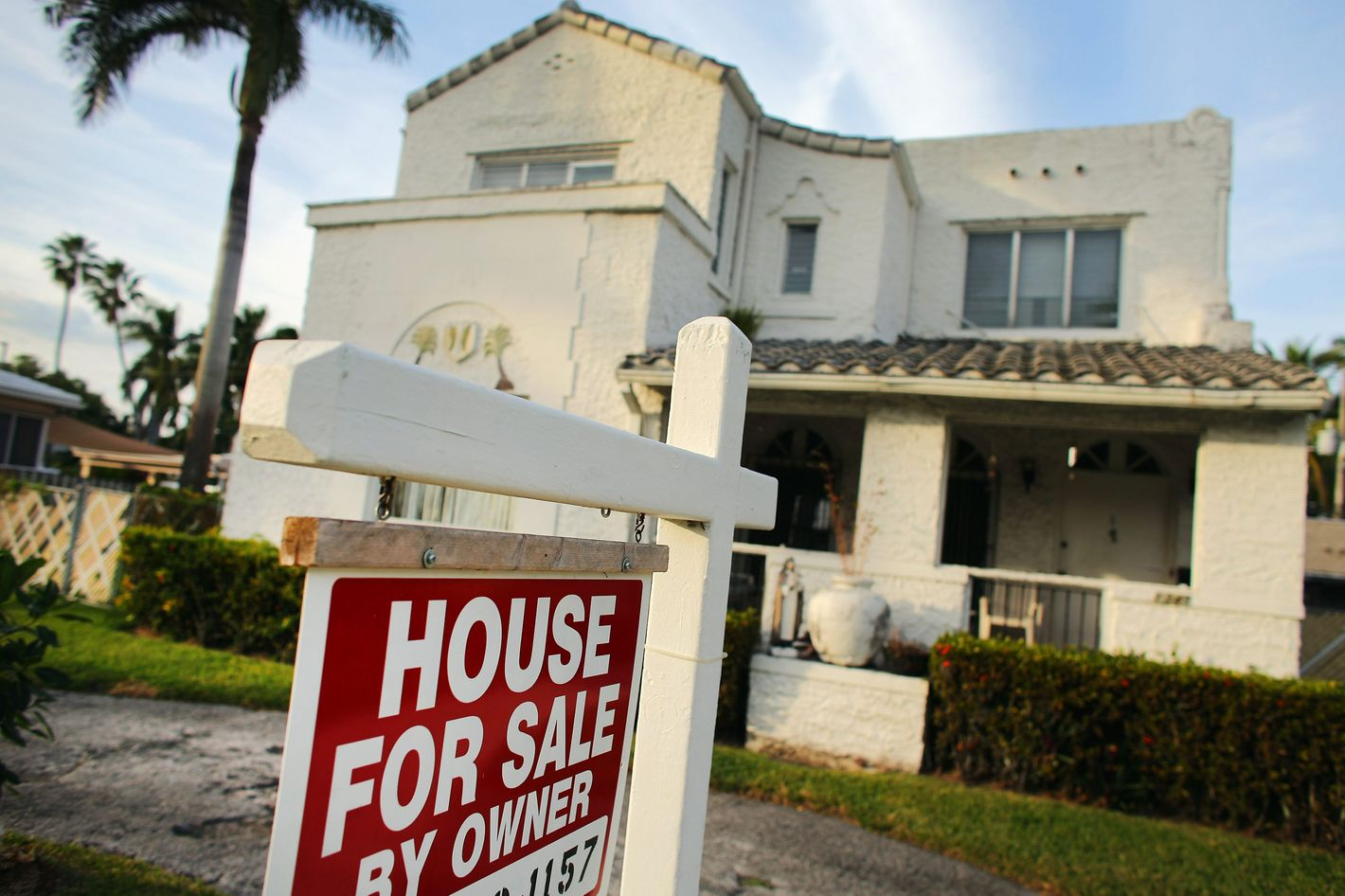 A 'For Sale' sign is posted in front of a house on November 28, 2012 in Hollywood, Florida.