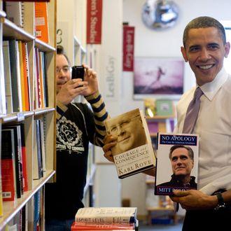 US President Barack Obama holds up copie