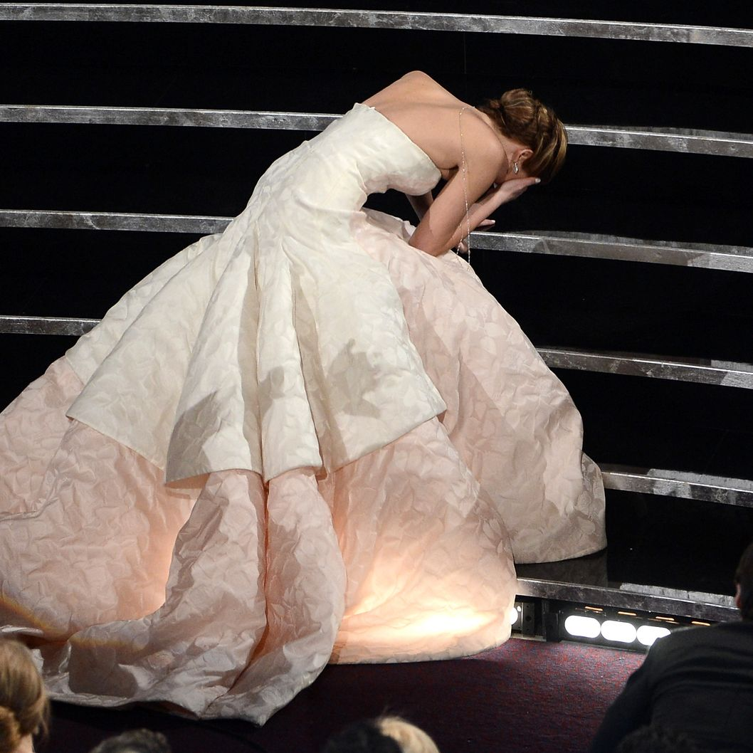 "HOLLYWOOD, CA - FEBRUARY 24:  Actress Jennifer Lawrence reacts after winning the Best Actress award for ""Silver Linings Playbook"" during the Oscars held at the Dolby Theatre on February 24, 2013 in Hollywood, California.  (Photo by Kevin Winter/Getty Images)"