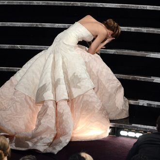 HOLLYWOOD, CA - FEBRUARY 24: Actress Jennifer Lawrence reacts after winning the Best Actress award for