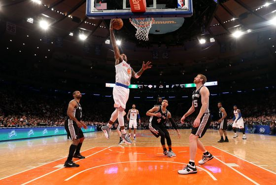 J.R. Smith #8 of the New York Knicks scores a second half basket against the San Antonio Spurs at Madison Square Garden on January 3, 2013 in New York City. NOTE TO USER: User expressly acknowledges and agrees that, by downloading and/or using this photograph, user is consenting to the terms and conditions of the Getty Images License Agreement. The Knicks defeated the Spurs 100-83.