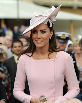 LONDON, UNITED KINGDOM - MAY 29: Catherine, Duchess of Cambridge meets guests during a garden party at Buckingham Palace on May 29, 2012 in London, England. (Photo by Anthony Devlin - WPA Pool /Getty Images)