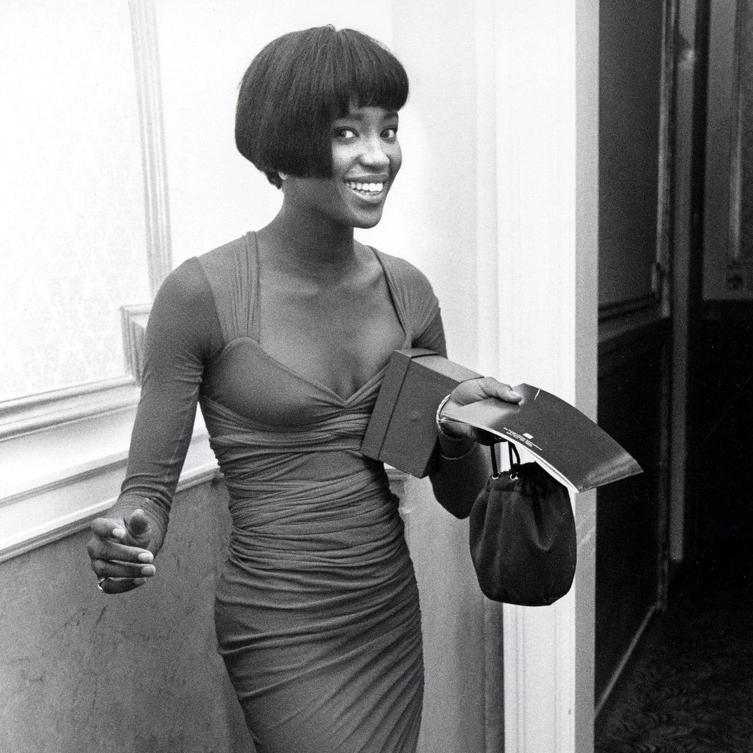 dress - Campbell naomi stars in photography exhibition video
