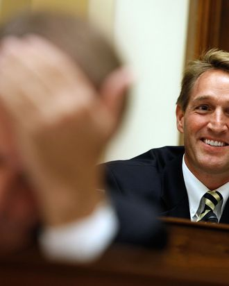 WASHINGTON - NOVEMBER 19: In a break with many in his party, House Foreign Affairs Committee member Rep. Jeff Flake (R-AZ) gives an opening statement about the need to lift the travel ban for U.S. citizens to Cuba on Capitol Hill November 19, 2009 in Washington, DC. The committee heard from witnesses on both sides of the issue as Congress gears up for a battle over Cuba policy, with proponents saying they have their best chance in years of repealing the decades-old ban on U.S. tourist travel to the island. (Photo by Chip Somodevilla/Getty Images) *** Local Caption *** Jeff Flake
