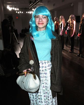 That blue wig is one of the things that was in her locker. We wonder if it violates her high school's dress code.