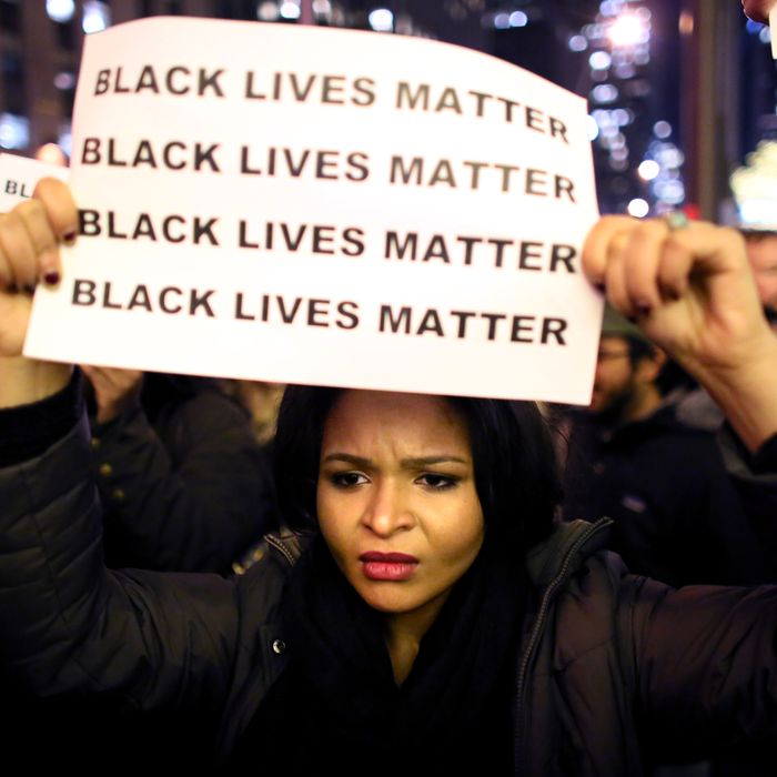 NEW YORK - DECEMBER 3: Demonstrators walk together during a protest December 3, 2014 in New York. Protests began after a Grand Jury decided to not indict officer Daniel Pantaleo. Eric Garner died after being put in a chokehold by Pantaleo on July 17, 2014. Pantaleo had suspected Garner of selling untaxed cigarettes. (Photo by Yana Paskova/Getty Images)