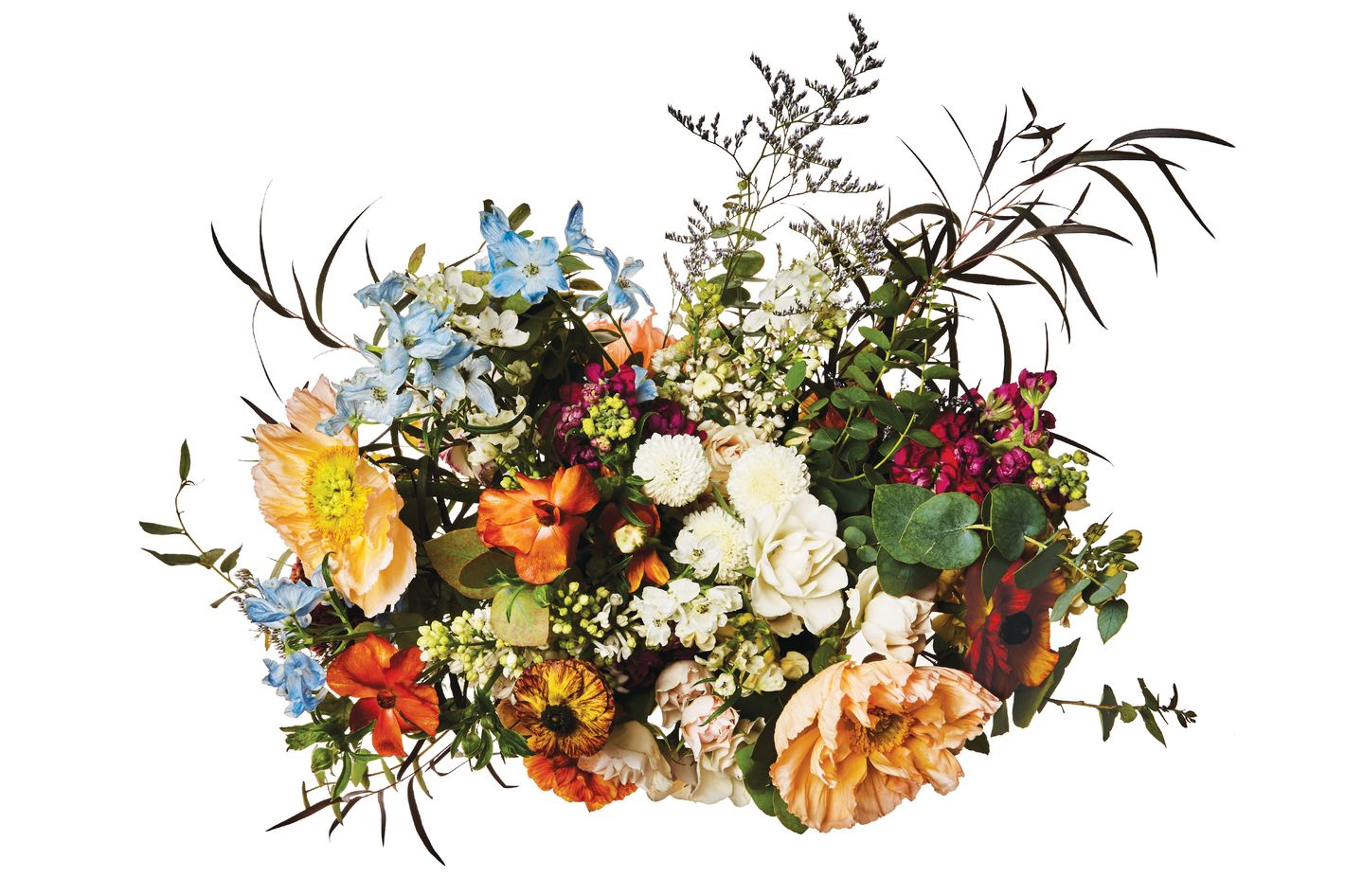 Clooney and Butterfly ranunculus, lilac, poppy, rainbow eucalyptus, delphinium, stock, and dried branches