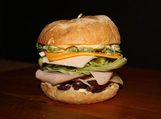 Foundling Club: Ham, turkey, olive salad, heirloom tomato, iceberg lettuce, avocado salad, and pickles.