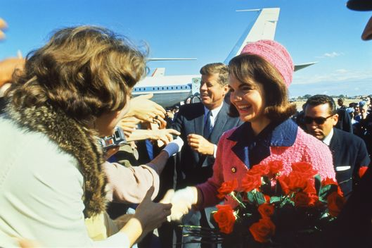 TEXAS, UNITED STATES - NOVEMBER 22:  President John F. Kennedy and wife Jackie greeting crowd at Love Field upon arrival for campaign tour on day of his assassination.  (Photo by Art Rickerby/Time & Life Pictures/Getty Images)