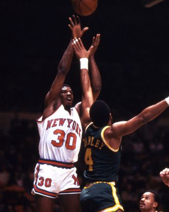 Bernard King of the New York Knicks shooting over Adrian Dantley on the Utah Jazz during a game at Madison Square Garden in 1984.