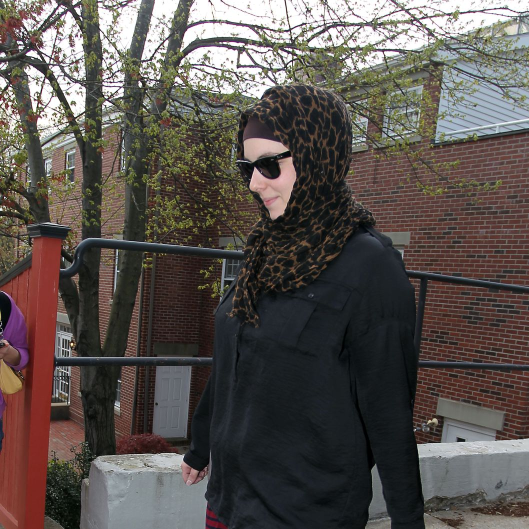 Katherine Russell, right, wife of Boston Marathon bomber suspect Tamerlan Tsarnaev, leaves the law office of DeLuca and Weizenbaum Monday, April 29, 2013, in Providence, R.I. (AP Photo/Stew Milne)