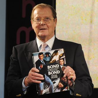 LONDON, UNITED KINGDOM - OCTOBER 22: Sir Roger Moore meets fans and signs copies of his book 'Bond on Bond' at HMV, Oxford Street on October 22, 2012 in London, England. (Photo by Stuart Wilson/Getty Images)