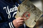 NEW YORK - APRIL 16:  A fan looks for tickets before the opening day game between the Cleveland Indians and the New York Yankees at the new Yankee Stadium on April 16, 2009 in the Bronx borough of New York City. This is the first regular season MLB game being played at the new venue which replaced the old Yankee Stadium as the Yankees home field.  (Photo by Chris McGrath/Getty Images)