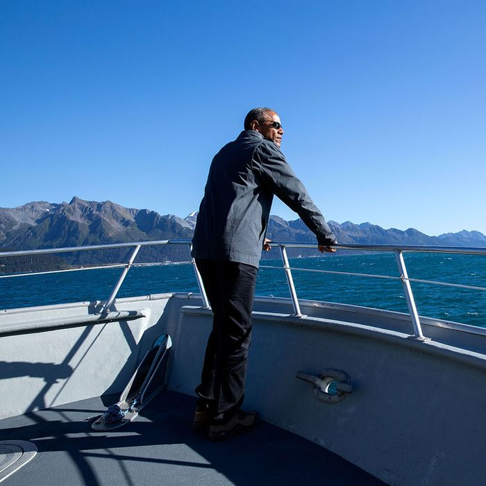 The President tours Kenai Fjords National Park in Alaska by boat.