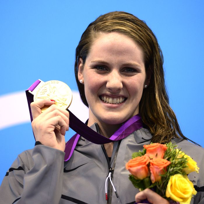 US swimmer Missy Franklin poses on the podium with the gold medal after winning the women's 100m backstroke swimming event at the London 2012 Olympic Games in the Aquatics Centre at the Olympic Park in London on July 30, 2012.