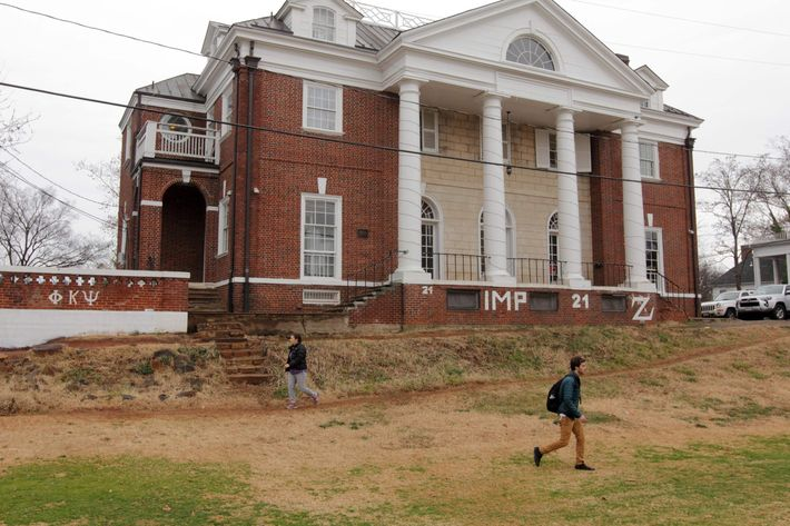 Students walk past the Phi Kappa Psi fraternity house on the University of Virginia campus on December 6, 2014 in Charlottesville, Virginia.