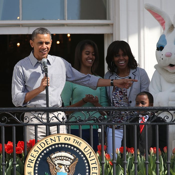 WASHINGTON, DC - APRIL 01: U.S. President Barack Obama speaks while flanked by his daughters Sasha (L), Malia, first lady Michelle Obama, Robby Novak and the Easter Bunny, during the annual Easter Egg Roll on the White House tennis court April 1, 2013 in Washington, DC. Thousands of people are expected to attend the 134-year-old tradition of rolling colored eggs down the White House lawn that was started by President Rutherford B. Hayes in 1878. (Photo by Mark Wilson/Getty Images)