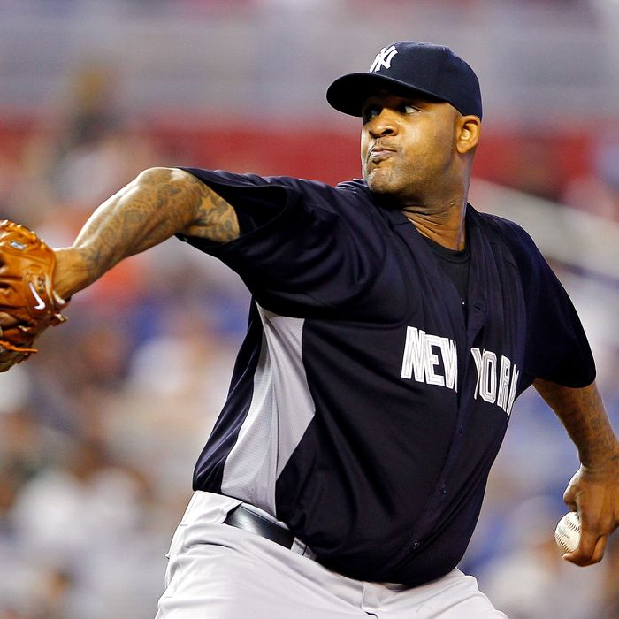 CC Sabathia #52 of the New York Yankees pitches during a game against the Miami Marlins
