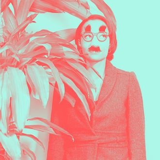 Businesswoman Hiding Behind Plant and Wearing Disguise