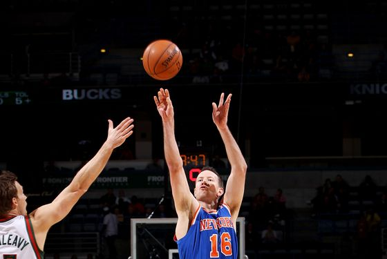 Steve Novak #16 of the New York Knicks shoots against Mike Dunleavy #17 of the Milwaukee Bucks during the game on November 28, 2012 at the BMO Harris Bradley Center in Milwaukee, Wisconsin.