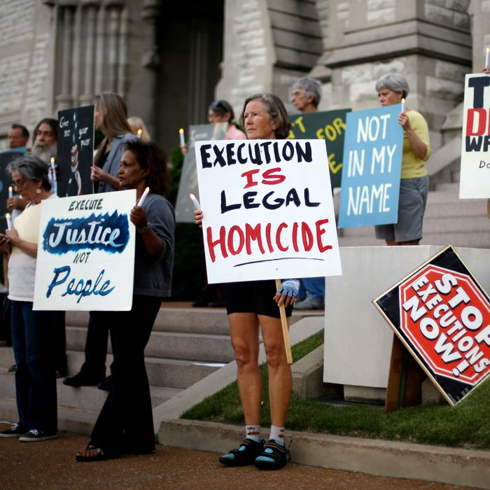 A group of death penalty opponents hold a vigil outside St. Francis Xavier College Church hours before the scheduled execution of Missouri death row inmate Russell Bucklew Tuesday, May 20, 2014, in St. Louis. A federal appeals court has granted a stay of execution for Bucklew, hours before he was scheduled to die for killing a southeast Missouri man in 1996. The 8th U.S. Circuit Court of Appeals on Tuesday cited concerns about Bucklews' rare medical condition, which raised the risk of