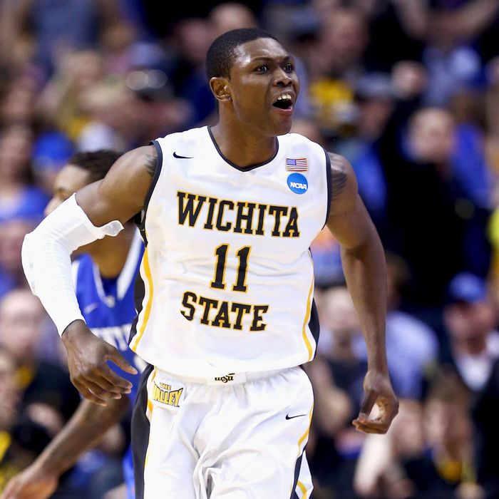 Cleanthony Early #11 of the Wichita State Shockers celebrates after a basket in the second half against the Kentucky Wildcats during the third round of the 2014 NCAA Men's Basketball Tournament at Scottrade Center on March 23, 2014 in St Louis, Missouri.