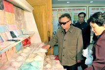 "This undated photo released by North Korea's official Korean Central News Agency (KCNA) on May 8, 2011 shows North Korean leader Kim Jong-Il (C) visiting the Rakrang Ponghwa Garment Factory in Pyongyang.   RESTRICTED TO EDITORIAL USE - MANDATORY CREDIT  "" AFP PHOTO / HO / KCNA via KNS "" - NO MARKETING NO ADVERTISING CAMPAIGNS - DISTRIBUTED AS A SERVICE OT CLIENTS (Photo credit should read KCNA/AFP/Getty Images)"
