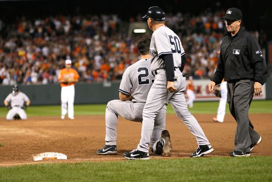 BALTIMORE, MD - SEPTEMBER 08: First base umpire Jerry Meals walks away after calling Mark Teixeira #25 of the New York Yankees out for the last out of the game during the Yankees 5-4 loss to the Baltimore Orioles at Oriole Park at Camden Yards on September 8, 2012 in Baltimore, Maryland. At right is first base coach Mick Kelleher.  (Photo by Rob Carr/Getty Images)