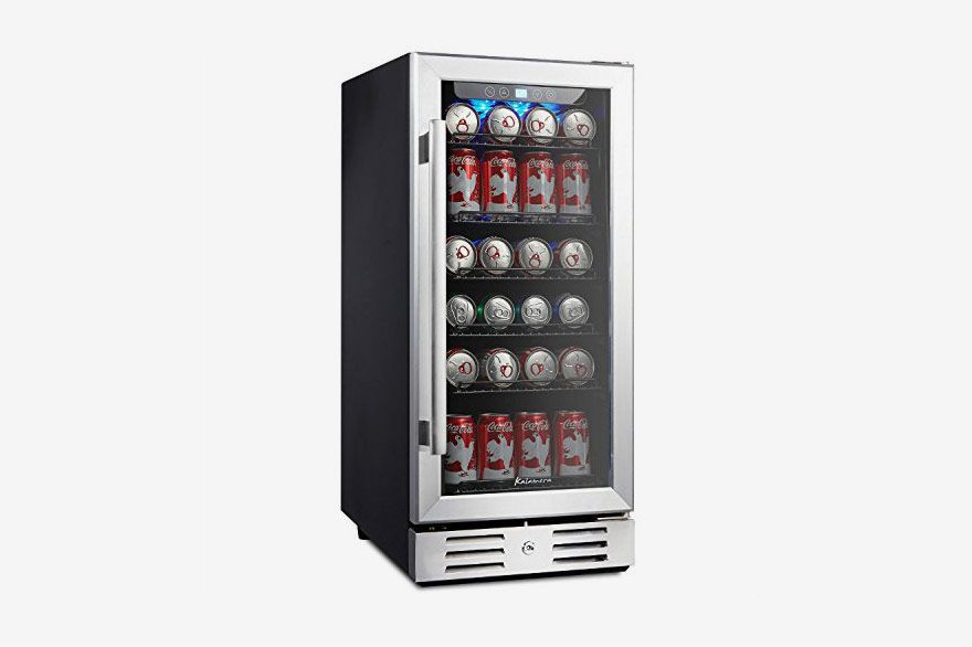A steel vending machine-like mini fridge with cans inside
